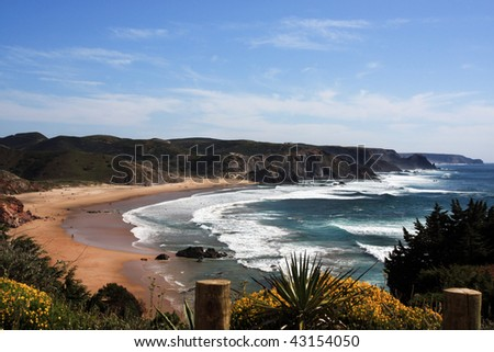 Wide view of the Amado beach coastline near Sagres, Portugal. - stock photo