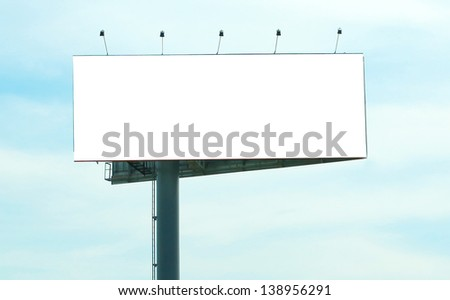 Wide white background of illuminated big blank billboard over cloudy blue sky - stock photo