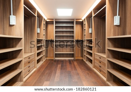 wide wooden dressing room, interior of a modern house - stock photo