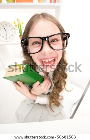 wideangle distorted picture of funny girl with green book - stock photo