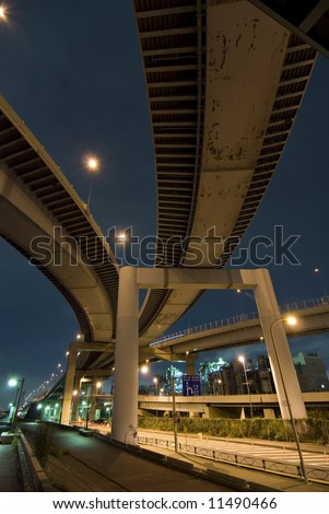 wideangle night image of well and high density organized Japanese urban roads area close to Arakawa river embankment, Tokyo, Japan