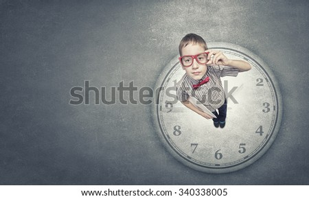 Wideangle picture of funny schoolboy with paper plane in hand - stock photo