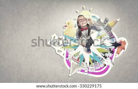 Wideangle picture of funny schoolgirl with paper plane - stock photo