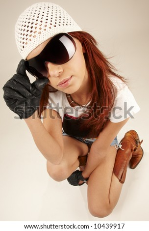 wideangle portrait of cool girl in big sunglasses - stock photo