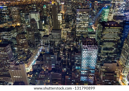 wideangle shot of skyscrapers lights in New York at night - stock photo