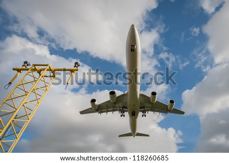 wideangle view of a passenger jet landing at an airport - stock photo