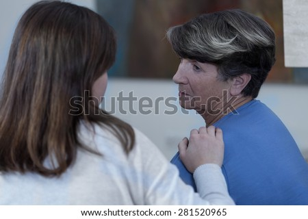 Widow in a mourning is comforted by a friend - stock photo