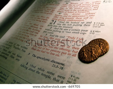 Widow's Mite.  Jesus commends a poor widow for giving generously. - stock photo