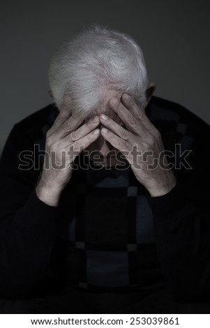 Widowed man mourning his lost love, vertical view - stock photo
