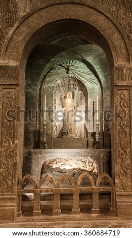 Wieliczka - Poland - April 23, 2015: One of the amazing sculptures made in salt, located on the side wall of St. Kinga CHapel in Wieliczka Salt Mine Museum.  - stock photo