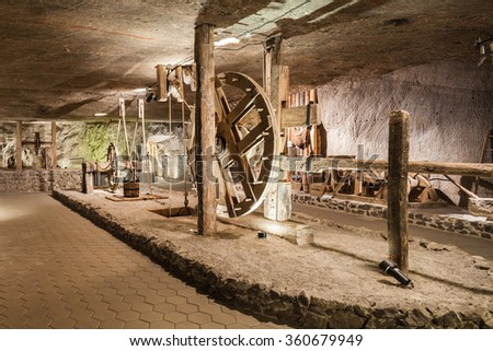Wieliczka - Poland - April 23, 2015: One of the chambers in Wieliczka Salt Museum transformed to exhibition room with wood man made mine lift.  - stock photo