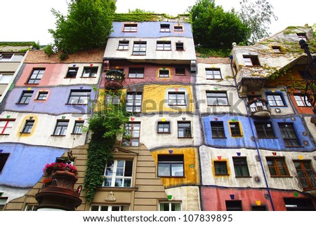 WIEN, AUSTRIA - JUNE 22: Front view of weird Hundertwasser Haus in Wien.  June 22, 2012 Wien, Austria.  The Hundertwasserhaus is an apartment house in Wien. This expressionist landmark of Vienna.