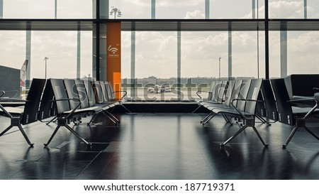 WIEN, AUSTRIA - MARCH 26, 2014: Walking room inside Wien International Airport. It is the country's biggest airport and serves as the hub for Austrian Airlines and its subsidiary Tyrolean Airways.