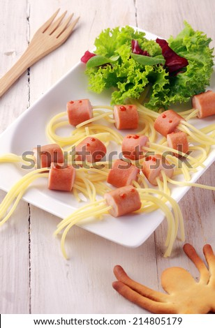 Wiener and Noodle Spider Snacks on White Plate with Garnish Shot from Above - stock photo
