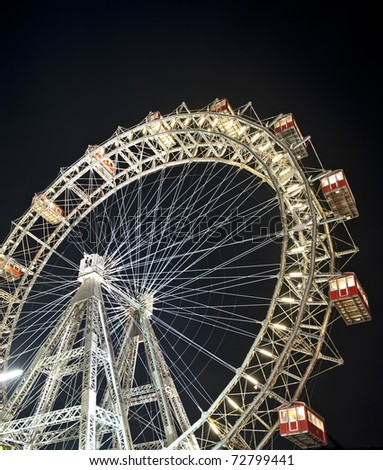 Wiener Riesenrad in Prater - oldest and biggest ferris wheel in Austria. Symbol of Vienna city at night - stock photo