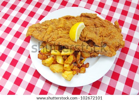 wiener schnitzel escalope viennese and roast potatoes - stock photo