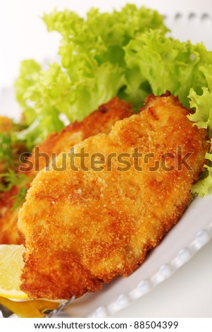 Wiener Schnitzel on white plate close up.