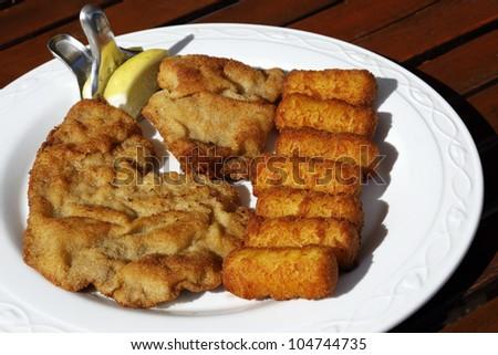 wiener schnitzel with potato croquettes - stock photo