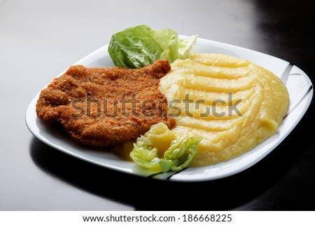 Wiener Schnitzel with pure potato - stock photo