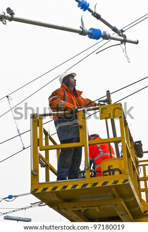 WIESBADEN, GERMANY - FEBRUARY 2:  worker repairs the catenary on February 2,2011 in Wiesbaden, Germany. The equipment is rented by Boehls, the leading rental company in Europe.