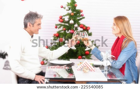 Wife and husband couple drinking champagne at home for Christmas time. - stock photo