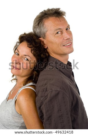 wife and husband in their 40s standing back to back, isolated on white