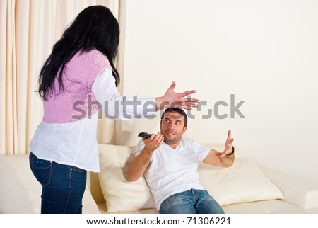 Wife and husband on couch having conflcit and arguing  home - stock photo