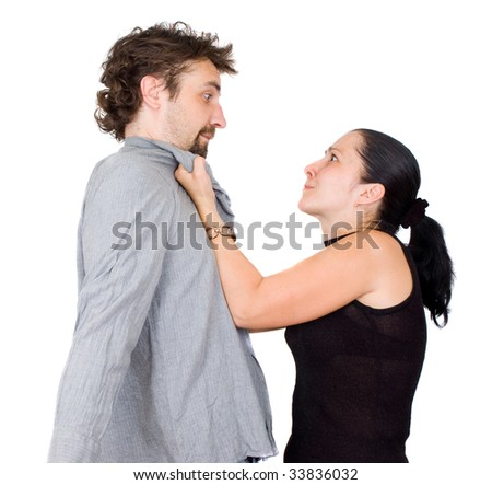 Wife and husband yelling at each other - stock photo