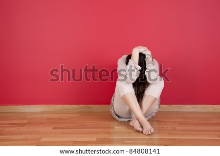 wife at home with fear - stock photo