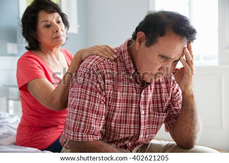 Wife Comforting Senior Husband Suffering With Dementia - stock photo