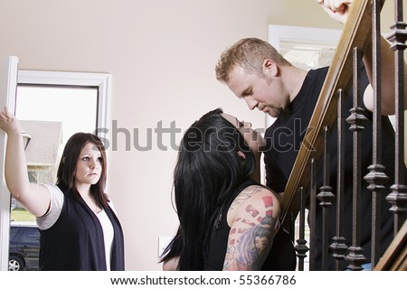 Wife Coming Home Finding Her Husband Cheating with another Woman - stock photo