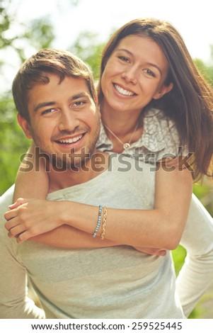 Wife embracing her husband - stock photo