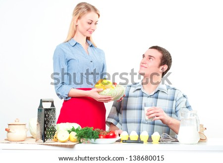 wife gives her husband a meal, have a nice time - stock photo