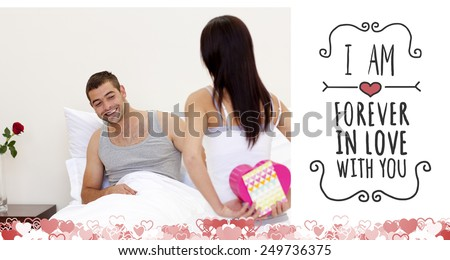 Wife giving her husband a valentine against valentines message - stock photo