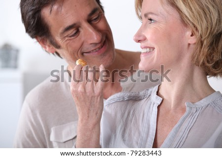 Wife giving husband a biscuit