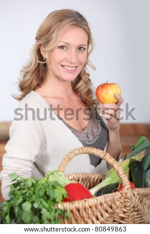 Wife holding apple. - stock photo