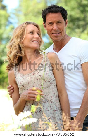 Wife looking at husband. - stock photo