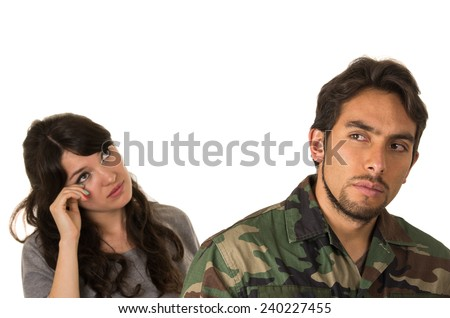 wife of military soldier crying goodby isolated on white - stock photo