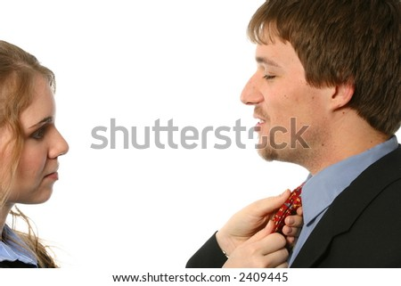 Wife or business associate fixing man's tie - stock photo