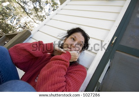 wife or woman on the porch - sad and worrying