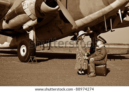 Wife saying good bye to pilot husband leaving for war - stock photo