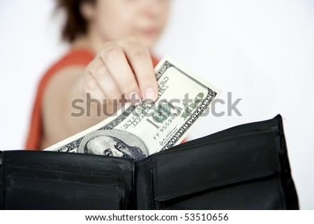 Wife taking money from husband's purse