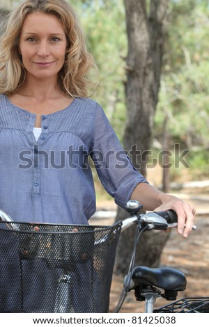 Wife with bicycle - stock photo