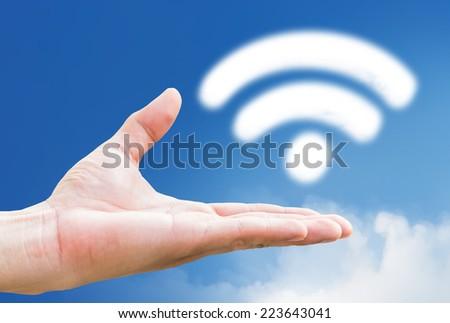 wifi cloud shape  on hand  - stock photo