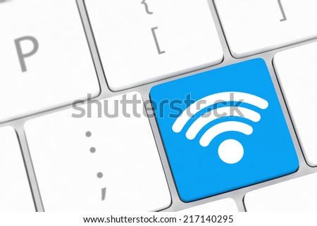 wifi concepts, with message on enter key of computer keyboard. - stock photo