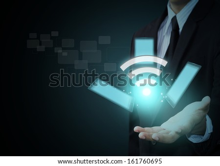 Wifi symbol and touch pad technology on businessman hand - stock photo