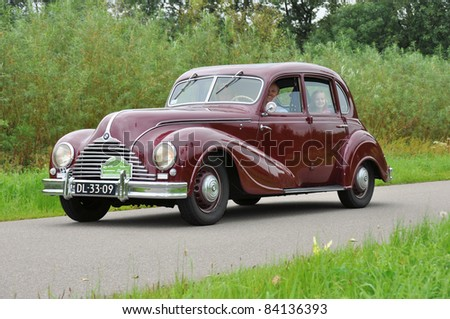 WIJHE, THE NETHERLANDS - SEPTEMBER 4: A BMW 340-2 from 1952 drives past at the 10th Diekdaegen classic car tour on September 4, 2011 in Wijhe, The Netherlands