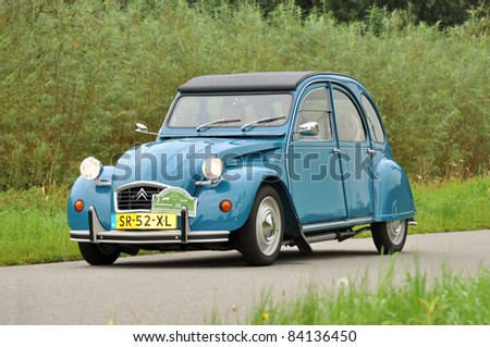 WIJHE, THE NETHERLANDS - SEPTEMBER 4: A Citroën 2CV 6 Club from 1983 drives past at the 10th Diekdaegen classic car tour on September 4, 2011 in Wijhe, The Netherlands - stock photo