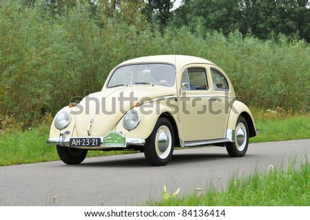 WIJHE, THE NETHERLANDS - SEPTEMBER 4: A Volkswagen Beetle 113 from 1960 drives past at the 10th Diekdaegen classic car tour on September 4, 2011 in Wijhe, The Netherlands - stock photo