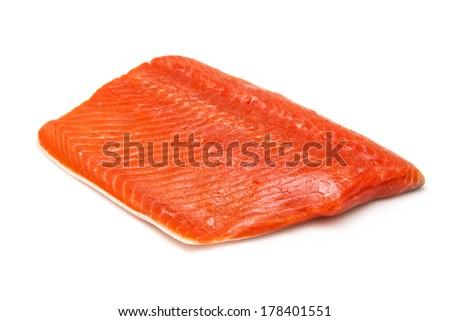 Wild Alaskan Sockeye or Coho Salmon fillet isolated on a white studio background. - stock photo